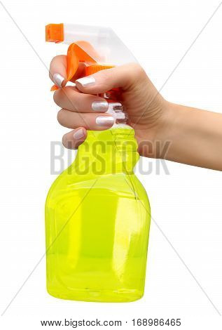 Sprayer with yellow liquid inside of it in female hand on white background