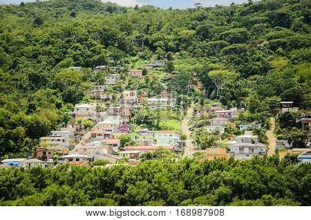 Small Village Of Several Colorful Houses On A Steep Mountain