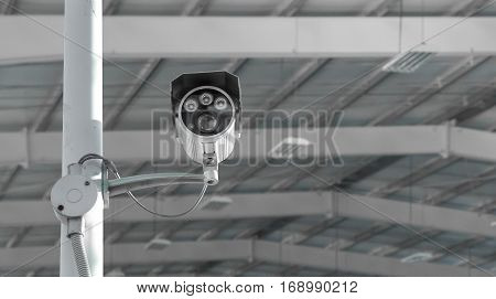 CCTV surveillance security camera video equipment in tower home and house building on wall for safety system area control outdoor with copyspace
