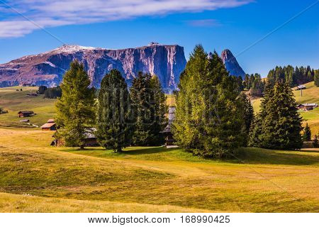 The Alps di Siusi. Well-known international ski resort in the fall. Jagged rocks around the Dolomites mountain valley. Concept of active and ecological tourism