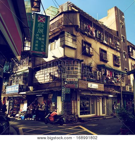 Taipei - December 2016: Quiet local street with people in sunny day.