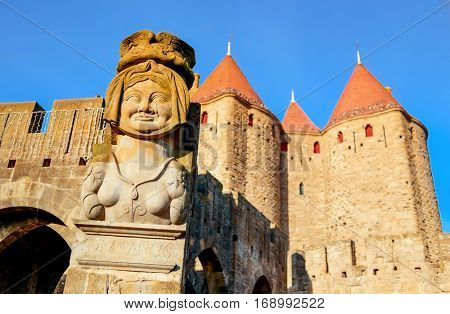 detail of the Narbone Gate and the walls and towers of the Cite de Carcassonne, in Carcassone, France