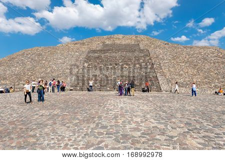 TEOTIHUACAN,MEXICO - DECEMBER 26,2016 : Tourists on top of the Pyramid of the Moon at Teotihuacan in Mexico