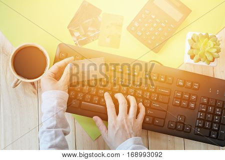E-commerce, business, finance, on-line shopping or payment concept : Hands holding credit card and using computer for on-line