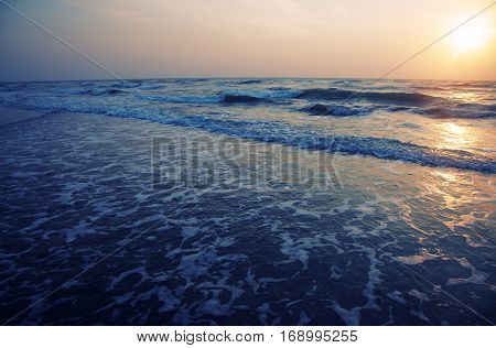 Horizontal photo of the sea during sunset. Natural darkness and colors