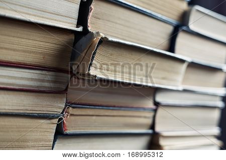 Stack of old worn book. Close-up view