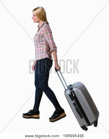 back view of walking  woman  with suitcase. beautiful girl in motion.  backside view of person. Rear view people collection. Isolated over white background. Long-haired woman rolls a suitcase in side