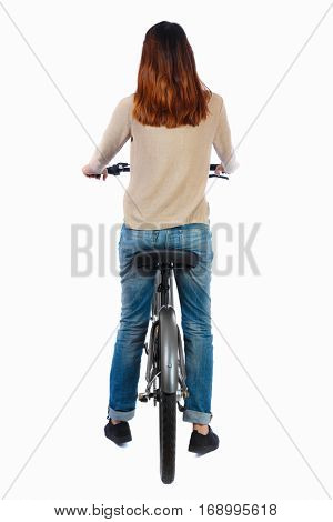 back view of a woman with a bicycle. cyclist sits on the bike. Rear view people collection.  backside view of person. Isolated over white background. Brunette on the bicycle looks around.