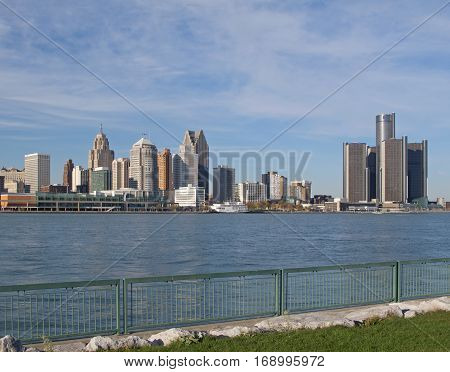 A good view of the skyline of downtown Detroit Michigan USA may be seen from Windsor Ontario Canada. The Detroit River which separates the neighboring cities flows here in an westerly direction for a few miles until the river turns and again flows south.