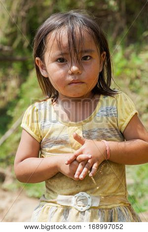 Ha Giang, Vietnam - Sep 22, 2013: Portrait of Hmong little girl child in front of her house