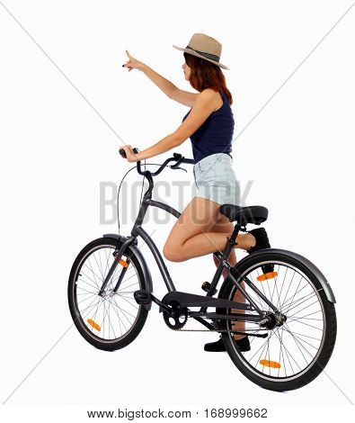 back view of pointing woman with a bicycle. cyclist sits on the bike. Rear view people collection.  backside view of person. Isolated over white background. Girl cyclist is crossing his frame.