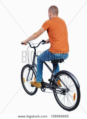 back view of a man with a bicycle. cyclist rides a bicycle. Rear view people collection.  backside view of person. Isolated over white background. The guy in the orange t-shirt riding a bicycle