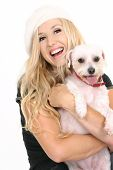 Laughing female holding a cute small white dog poster