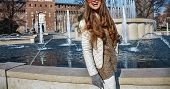 Rediscovering things everybody love in Milan. happy young tourist woman in Milan Italy looking into the distance poster