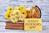 Teacher's Day card and flowers. Globe and stack of books. Appreciate your teacher. poster