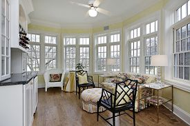 Sun room in upscale home with wall of windows.