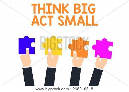 Handwriting Text Think Big Act Small. Concept Meaning Great Ambitious Goals Take Little Steps One At