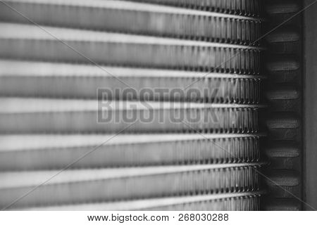 Monochrome background image of automotive radiator close up. Silver background from many duplicate lines. poster