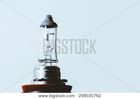 Detail Image Of Dipped Beam Bulb With Filament Close-up On Blue Background With Copy Space.