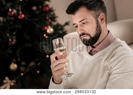 Unhappy Bearded Male Looking At His Bocal