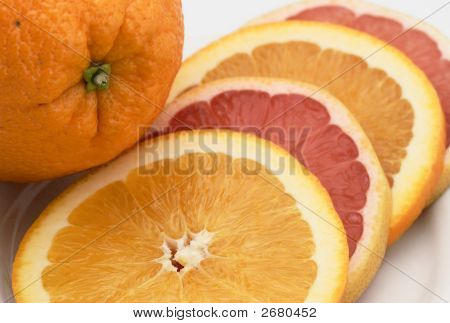 Sliced Orange And Pink Grapefruit