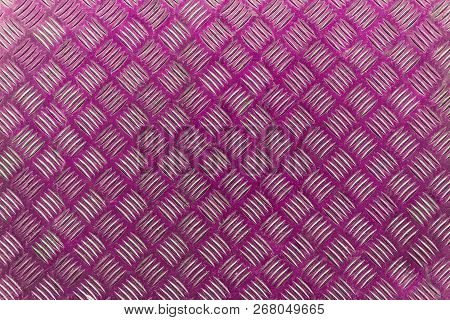 Close-up Of A Pink Colored Wall With A Striped Pattern. View To A Purple Shiny Metallic Wall. Geomet