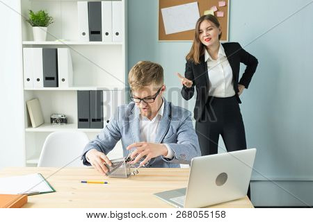 Business, Emotions And People Concept - Business Woman Shout At Male Worker In Office Place