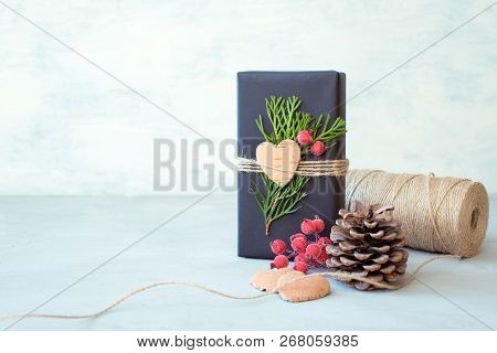 Christmas Wrapping. Gift Box, Present With Craft Wrapping Paper, Twine, Coniferous Branches, Red Ber
