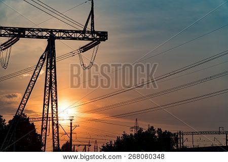 Sunset Under The High-voltage Tower In The Background.