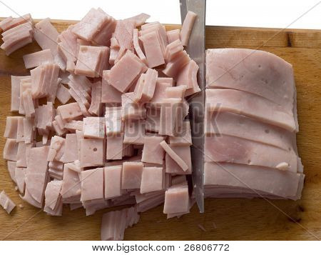 cutting boiled hame on the wooden board