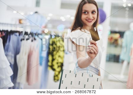 Woman In Shopping. Happy Woman With Shopping Bags And Credit Card Enjoying In Shopping. Consumerism,