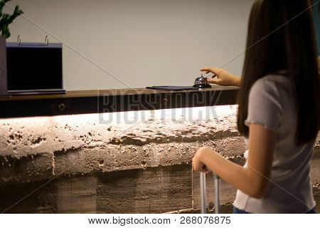 Close Up Women Call Hotel Reception On Counter Desk With Finger Push A Bell In Lobby Hotel. Hotel Co
