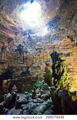 Grotta Di Castellano, Apulia, Italy - Impressive Stone Formations Illuminated Through A Hole