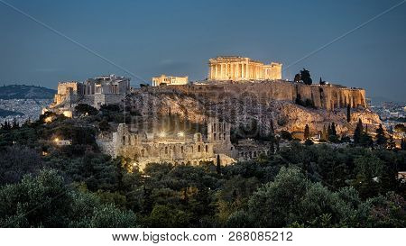 Night Panoramic View Of Acropolis, Athens, Greece. Famous Acropolis Hill Is The Main Landmark Of Ath