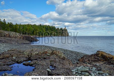 Panoramic View Of The Split Rock Lighthouse From A Nearby Rocky Beach