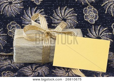blank yellow paper note in the holiday arrangement