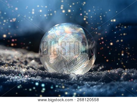 Magical Color Glitter Frostball On Cold Winter Snow, Crystal Formations, Dark Background