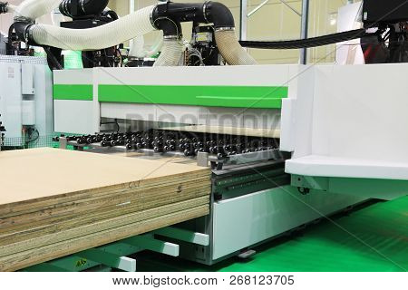 Cutting sheets of material wood chipboard. Manufacture of wood chipboard. poster