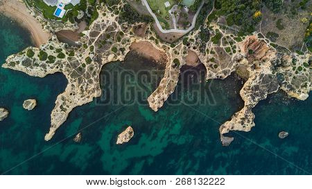 Aerial View Of The Beautiful Beaches Of Coast Algarve Coast, Portugal. Concept For Above Beach Of Po