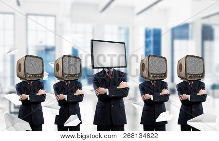 Businessmen In Suits With Old Tv Instead Of Their Heads Keeping Arms Crossed While Standing In A Row