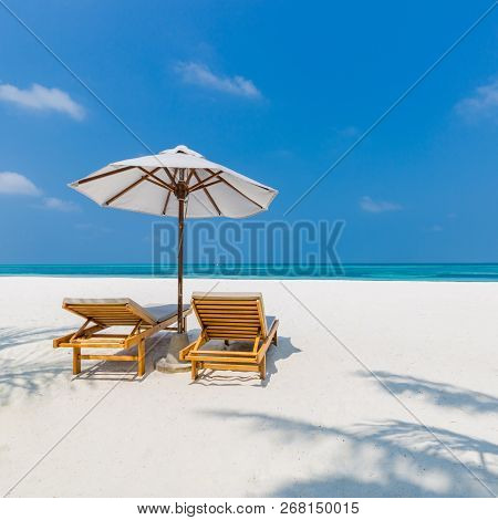 Idyllic Beach Background For Couples Getaway And Honeymoon Concept Design. White Sand, Blue Sky Two