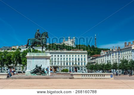 Lyon, France - July 18, 2018: The Bellecour Square In Lyon With Statue Of Louis Xiv And Basilica Of