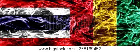 Thailand Vs Guinea, Guinean Smoke Flags Placed Side By Side. Thick Abstract Colored Silky Smoke Flag