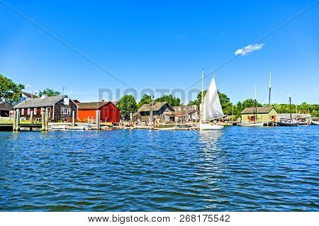 Mystic, Ct, Usa - July 6, 2014: People Enjoy A Sunny Day In The Mystic Seaport. Mystic Is One Of Con