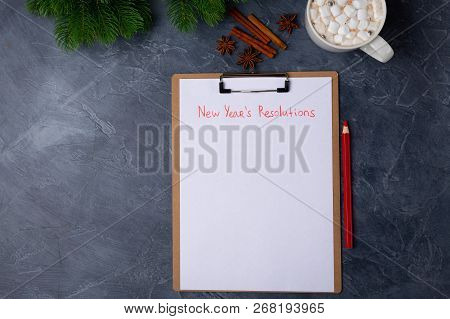Blank Paper With New Years Resolutions Flat Lay. Top View. New Year Concept. Personal Goals Targets