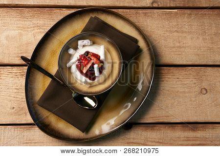 Estonian sweet dessert Kama with yoghurt mousse, wild berries an poster