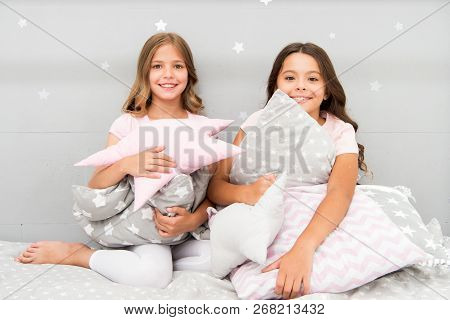 Girls Happy Best Friends Or Siblings In Cute Stylish Pajamas With Pillows Sleepover Party. Sisters P