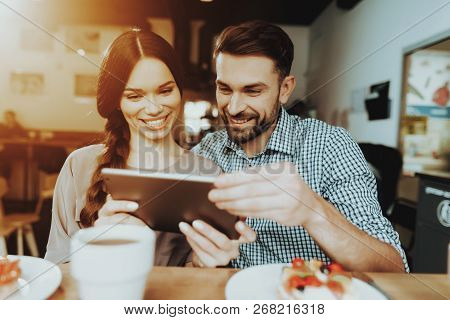 Happy Man and Young Girl. 8 March Gift for Beloved. Food and Drinking Tea. Family Together. Smile and Happy Together. Woman and Man Happy Together. Family in Day 8 March. Relationship with Good Gift. poster