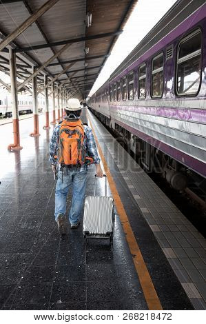 Asian Traveler Man With Belongings Waiting For Travel By Train At Chiang Mai Train Station, Thailand