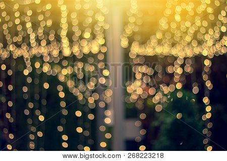 Blurred Night Light With Bokeh In Festival. Christmas Abstract Light Background.